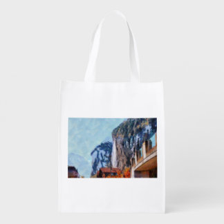 Towering cliffs and houses reusable grocery bag