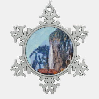 Towering cliffs and houses snowflake pewter christmas ornament