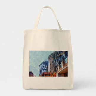 Towering cliffs and houses tote bag