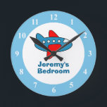 "Toy airplane wall clock for boy bedroom or nursery<br><div class=""desc"">Toy airplane wall clock for kids bedroom or baby nursery. Aviation theme design. Airliner illustration. Personalized round wallclock with plane and custom name of child. Cute baby shower or 1st Birthday gift idea for little boys room. Air plane illustration decoration with personalizable name or monogram. Home decor for childrens room...</div>"