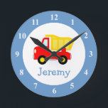 "Toy dump truck wall clock for kids bedroom nursery<br><div class=""desc"">Toy dump truck wall clock for kids bedroom or baby nursery. Personalized wallclock with custom name of child. Cute baby shower or 1st Birthday gift idea for little boys room. Red dumptruck construction vehicle decoration with personalizable name or monogram. Home decor for childrens room wall. Make your own unique present...</div>"