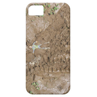 Toy man pushed into mud. iPhone 5 cover
