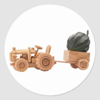 Toy tractor with green pumpkin. classic round sticker