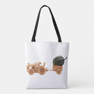 Toy tractor with green pumpkin. tote bag