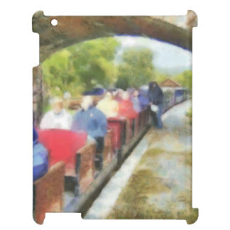 Toy train and adult passengers cover for the iPad
