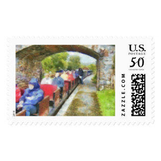 Toy train and adult passengers postage