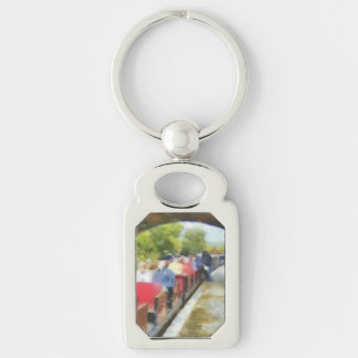 Toy train and adult passengers Silver-Colored rectangular metal keychain