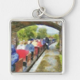 Toy train and adult passengers Silver-Colored square keychain