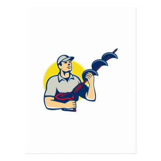 Trabajador del constructor con el taladro de la postales