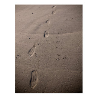 Traces in the sand - beach footprints postcard