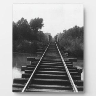 Tracks across the water photo plaque