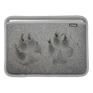 Tracks of dog in sand MacBook sleeves
