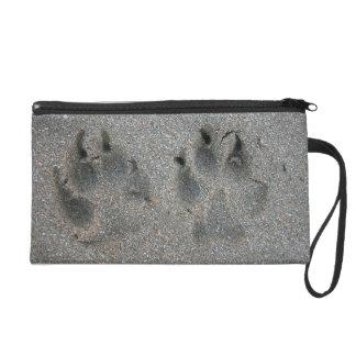 Tracks of dog in sand wristlet purse