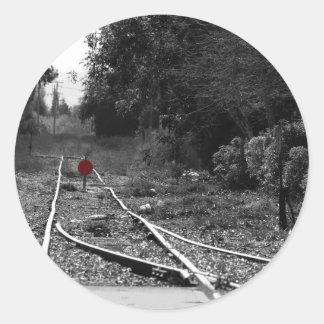 Tracks to nowhere round sticker