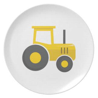 Tractor amarillo platos de comidas