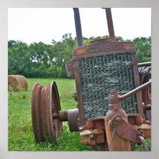 Tractor antiguo oxidado del caso impresiones