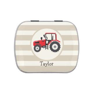 Tractor de granja rojo en rayas del moreno frascos de caramelos