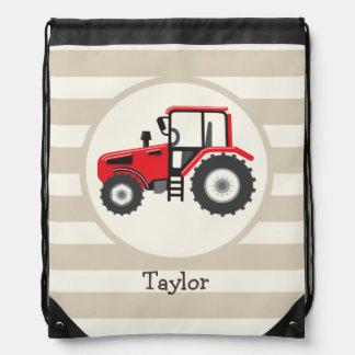 Tractor de granja rojo en rayas del moreno mochila