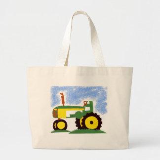 Tractor debajo del cielo azul bolsas lienzo