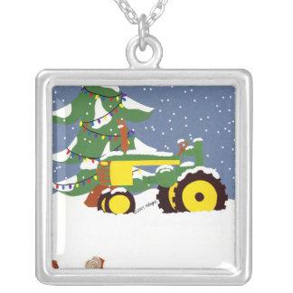 Tractor del navidad con el collar del árbol y de l
