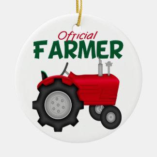 Tractor del rojo del granjero adorno navideño redondo de cerámica