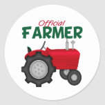 Tractor del rojo del granjero pegatina redonda
