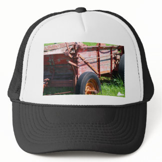 Tractor in  a field trucker hat