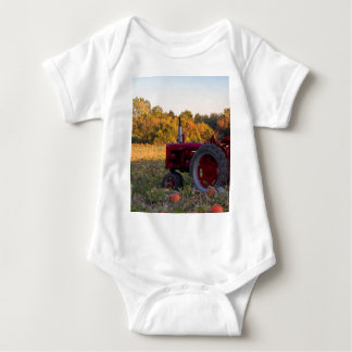 Tractor in a pumpkin field baby bodysuit