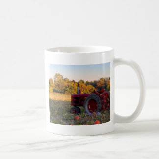 Tractor in a pumpkin field coffee mug