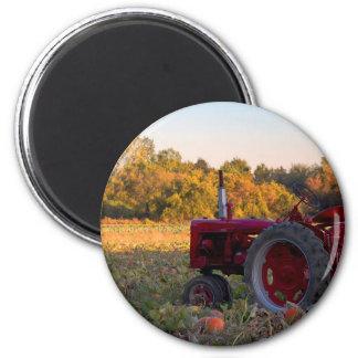 Tractor in a pumpkin field magnet