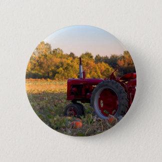 Tractor in a pumpkin field pinback button