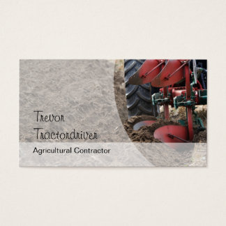 Tractor plowing a field close-up photo business card