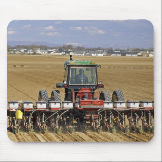 Tractor pulling a seed corn planter. mouse pad