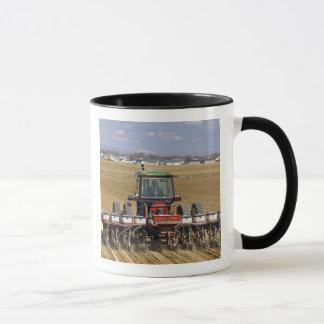 Tractor pulling a seed corn planter. mug