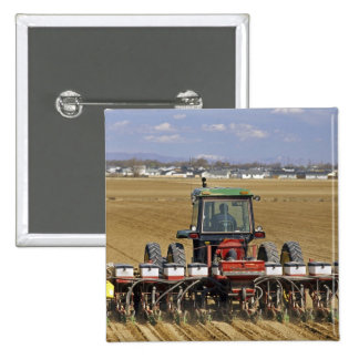Tractor pulling a seed corn planter. pinback button
