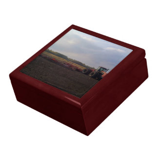Tractor resting after tilling jewelry boxes