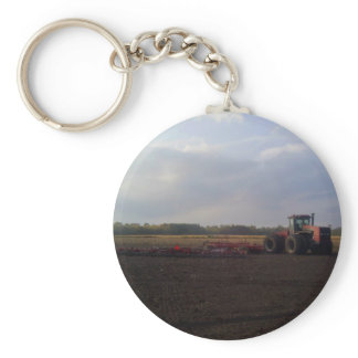 Tractor resting after tilling keychain