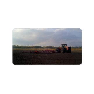 Tractor resting after tilling label