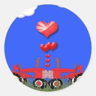 Tractor rojo con el pegatina del sello del sobre d