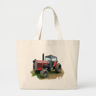Tractor rojo de Massey Ferguson en el campo Bolsas