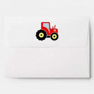 Tractor rojo del juguete sobre