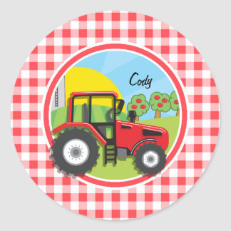 Tractor rojo en la guinga roja y blanca etiqueta redonda