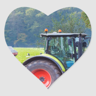 Tractor with agricultural machine on land.JPG Heart Sticker