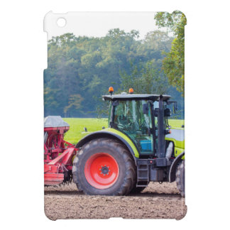 Tractor with agricultural machine on land.JPG iPad Mini Cases