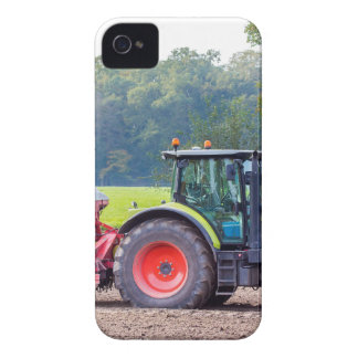 Tractor with agricultural machine on land.JPG iPhone 4 Case