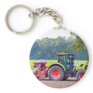Tractor with agricultural machine on land.JPG Keychain