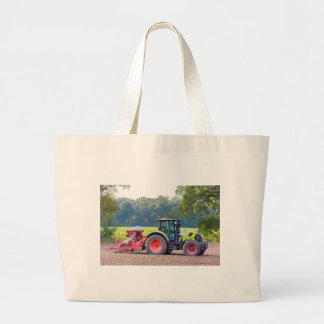 Tractor with agricultural machine on land.JPG Large Tote Bag