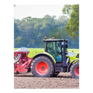 Tractor with agricultural machine on land.JPG Letterhead