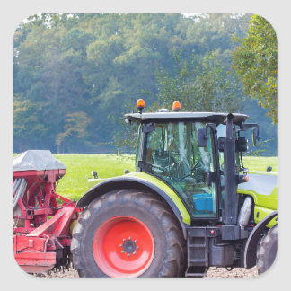 Tractor with agricultural machine on land.JPG Square Sticker