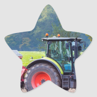 Tractor with agricultural machine on land.JPG Star Sticker